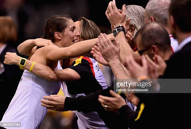 Andrea Petkovic of Germany celebrates with team mates after her victory in her single match against Samantha Stosur of Australia during the Fed Cup...