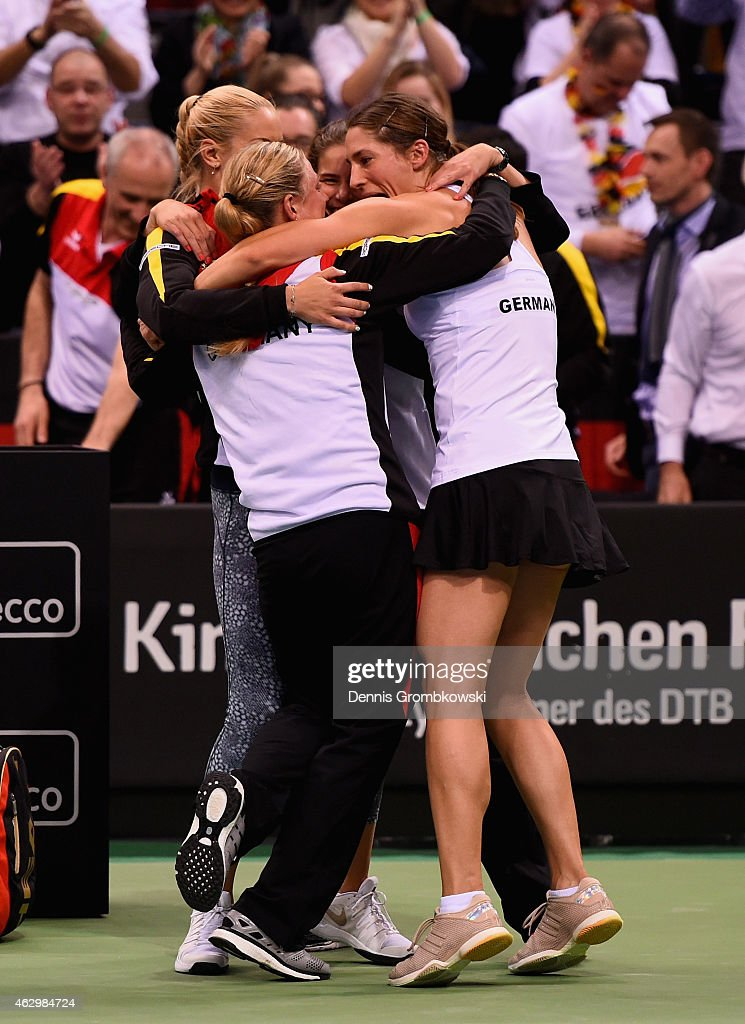 Andrea Petkovic of Germany celebrates with team mates after her victory in her single match against Jarmila Gajdosova of Australia during the Fed Cup 2015 World Group First Round tennis between Germany and Australia at Porsche-Arena on February 8, 2015 in Stuttgart, Germany.