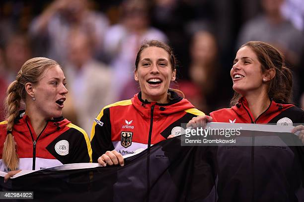Andrea Petkovic of Germany celebrates with team mates Angelique Kerber and Julia Goerges after her single match against Jarmila Gajdosova of...
