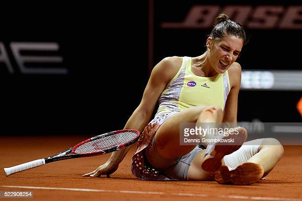 Andrea Petkovic of Germany falls during her match against Agnieszka Radwanska of Poland during Day 4 of the Porsche Tennis Grand Prix at PorscheArena...