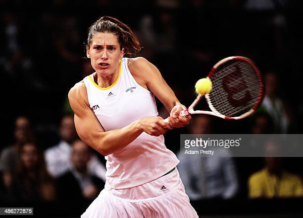 Andrea Petkovic of Germany hits a backhand during her match against Flavia Pennetta of Italy during day 3 of the Porsche Tennis Grand Prix 2014 at...
