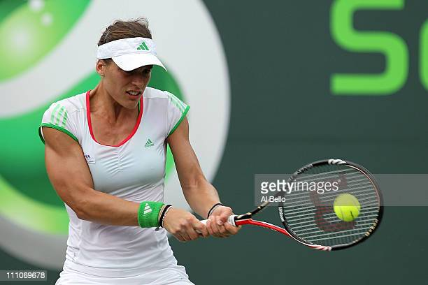 Andrea Petkovic of Germany hits a backhand return against Jelena Jankovic of Serbia during the Sony Ericsson Open at Crandon Park Tennis Center on...