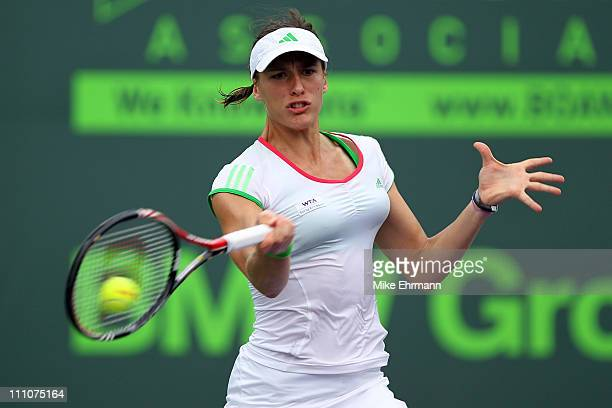 Andrea Petkovic of Germany hits a forehand return against Jelena Jankovic of Serbia during the Sony Ericsson Open at Crandon Park Tennis Center on...