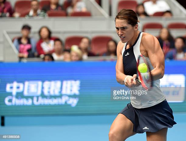 Andrea Petkovic of Germany hits a return against Eugenie Bouchard of Canada during their first round women's singles match at the China Open tennis...