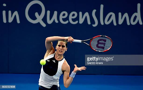 Andrea Petkovic of Germany hits a return against Teliana Pereira of Brazil in their first round women's singles match at the Brisbane International...