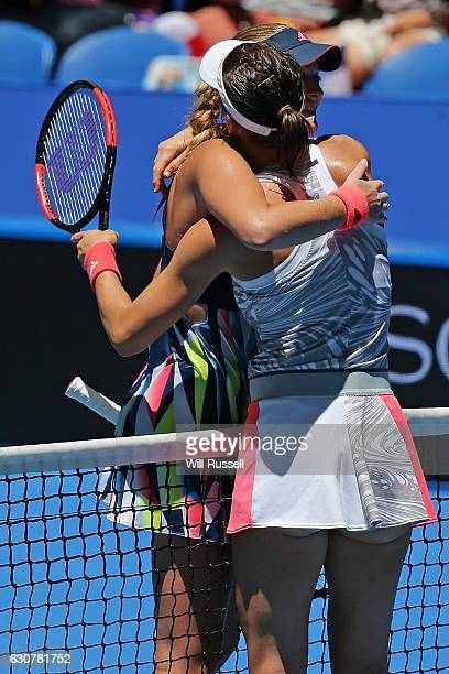 Andrea Petkovic of Germany hugs Kristina Mladenovic of France after defeating her in the Womens single match on day two of the 2017 Hopman Cup at...