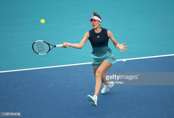 Andrea Petkovic of Germany in action against Amanda Anisimova of USA during day three of the Miami Open tennis on March 20 2019 in Miami Gardens...