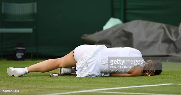 Andrea Petkovic of Germany lies on the court after slipping during the Ladies Singles second round match against Elena Vesnina of Russia on day four...