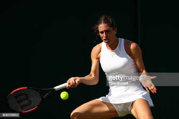 Andrea Petkovic of Germany plays a backhand during the Ladies Singles first round match on day one of the Wimbledon Lawn Tennis Championships at the...
