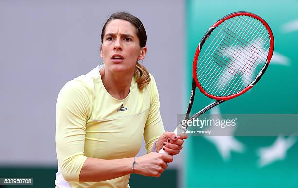 Andrea Petkovic of Germany plays a backhand during the Women's Singles first round match against Laura Robson of Great Britain on day three of the...