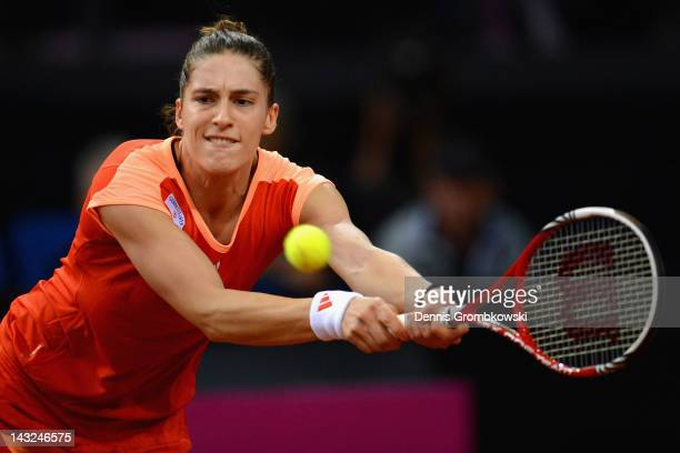 Andrea Petkovic of Germany plays a backhand in her match against Samantha Stosur of Australia during day two of the Federation Cup 2012 World Group...