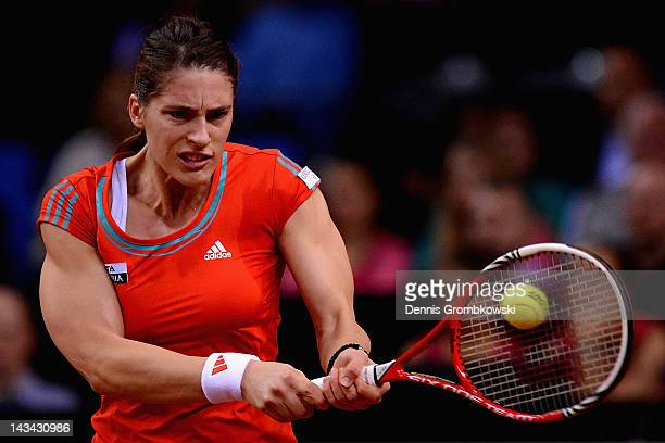 Andrea Petkovic of Germany plays a backhand in her match against Victoria Azarenka of Belarus during day four of the WTA Porsche Tennis Grand Prix at...