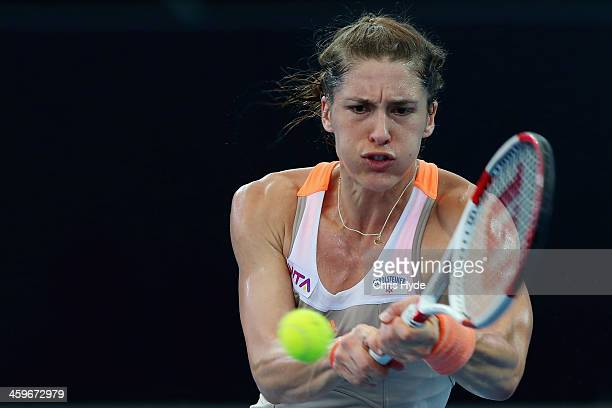 Andrea Petkovic of Germany plays a backhand in her match against Bethanie MattekSands of the USA during day one of the 2014 Brisbane International at...