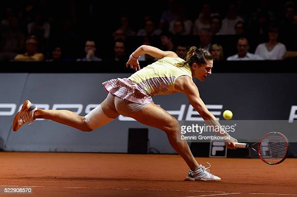 Andrea Petkovic of Germany plays a backhand in her match against Agnieszka Radwanska of Poland during Day 4 of the Porsche Tennis Grand Prix at...