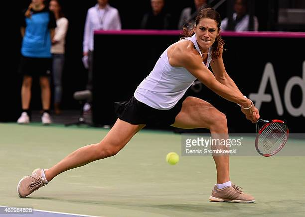 Andrea Petkovic of Germany plays a backhand in her single match against Jarmila Gajdosova of Australia during the Fed Cup 2015 World Group First...