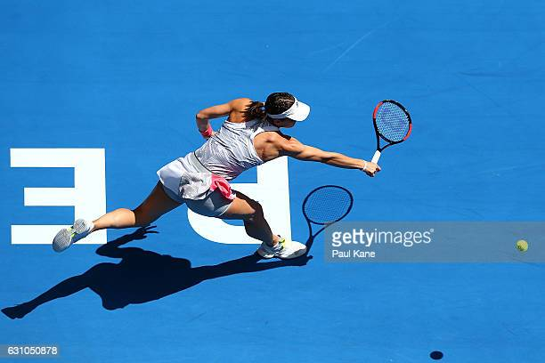 Andrea Petkovic of Germany plays a backhand to Heather Watson of Great Britain in the women's singles match during day six of the 2017 Hopman Cup at...