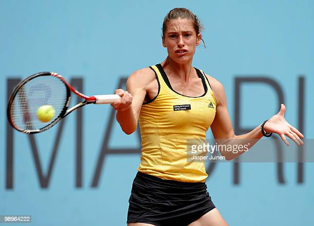 Andrea Petkovic of Germany plays a ball to Flavia Pennetta of Italy in their second round match during the Mutua Madrilena Madrid Open tennis...