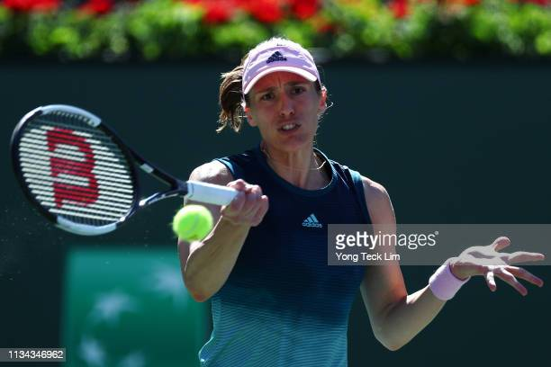 Andrea Petkovic of Germany plays a forehand against Venus Williams of the United States during their women's singles first round match against on Day...