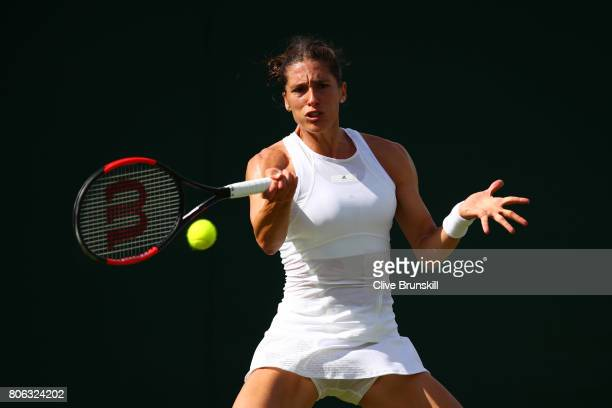 Andrea Petkovic of Germany plays a forehand during the Ladies Singles first round match on day one of the Wimbledon Lawn Tennis Championships at the...