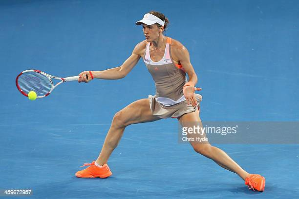 Andrea Petkovic of Germany plays a forehand in her match against Bethanie MattekSands of the USA during day one of the 2014 Brisbane International at...