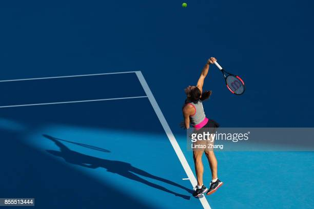 Andrea Petkovic of Germany plays a shot against Beatriz Haddad Maia of Brazil during the Women's singles qualifier first round of the 2017 China Open...