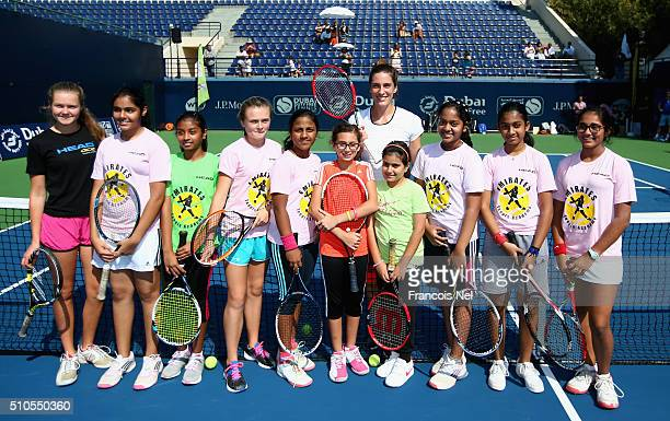 Andrea Petkovic of Germany poses with children after their kids clinic during day two of the WTA Dubai Duty Free Tennis Championship at the Dubai...