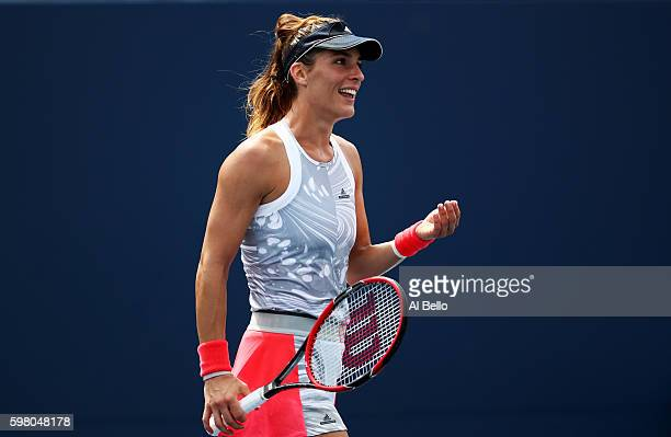 Andrea Petkovic of Germany reacts against Belinda Bencic of Switzerland during her second round Women's Singles match on Day Three of the 2016 US...