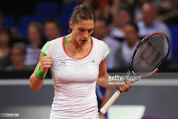 Andrea Petkovic of Germany reacts during her first round match against Tamira Paszek of Austria at the Porsche Tennis Grand Prix at Porsche Arena on...