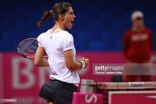 Andrea Petkovic of Germany reacts during her match against Christina McHale of the USA during the first day of the Fed Cup match between Germany and...