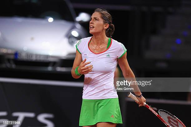 Andrea Petkovic of Germany reacts during her second round match against Jelena Jankovic of Serbia at the Porsche Tennis Grand Prix at Porsche Arena...