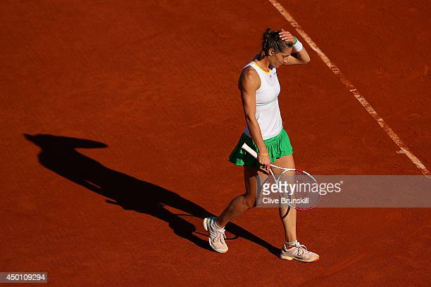 Andrea Petkovic of Germany reacts during her women's singles match against Simona Halep of Romania on day twelve of the French Open at Roland Garros...