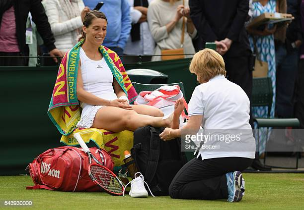 Andrea Petkovic of Germany recieves physio treatment during the Ladies Singles second round match against Elena Vesnina of Russia on day four of the...