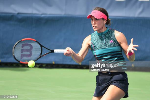 Andrea Petkovic of Germany returns a forehand shot to Belinda Bencic Switzerland during Day Seven of the Citi Open at the Rock Creek Tennis Center on...