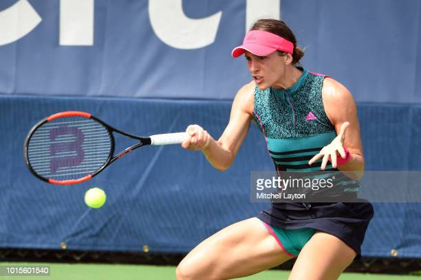 Andrea Petkovic of Germany returns a forehand shot to Belinda Bencic of Switzerland during Day Seven of the Citi Open at the Rock Creek Tennis Center...