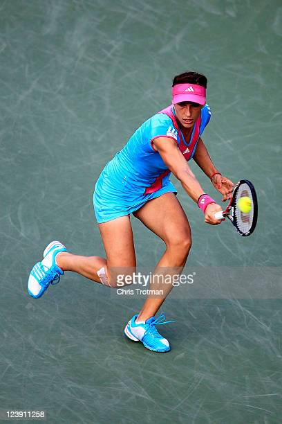 Andrea Petkovic of Germany returns a shot against Carla Suarez Navarro of Spain during Day Eight of the 2011 US Open at the USTA Billie Jean King...