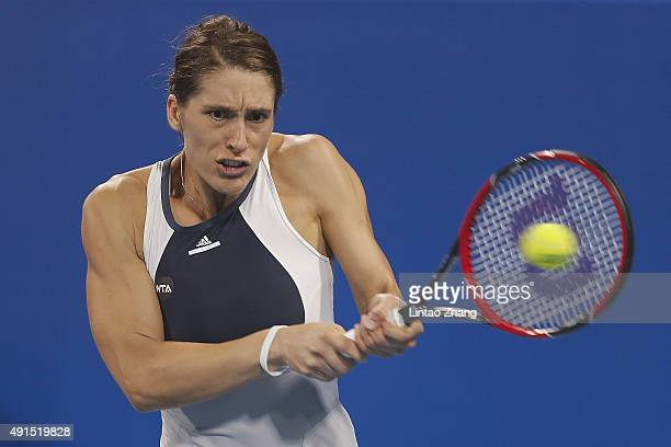 Andrea Petkovic of Germany returns a shot against Samantha Stosur of Australia during the Women's singles Second round match on day four of the 2015...