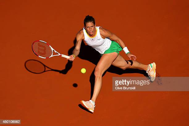 Andrea Petkovic of Germany returns a shot during her women's singles match against Simona Halep of Romania on day twelve of the French Open at Roland...