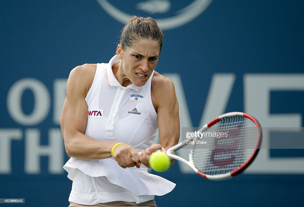 Andrea Petkovic of Germany returns a shot to Ajla Tomljanovic of Crotia during Day 1 of the Bank of the West Classic at the Taube Family Tennis Stadium on July 28, 2014 in Stanford, California.