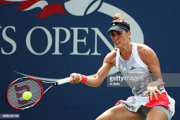 Andrea Petkovic of Germany returns a shot to Belinda Bencic of Switzerland during her second round Women's Singles match on Day Three of the 2016 US...