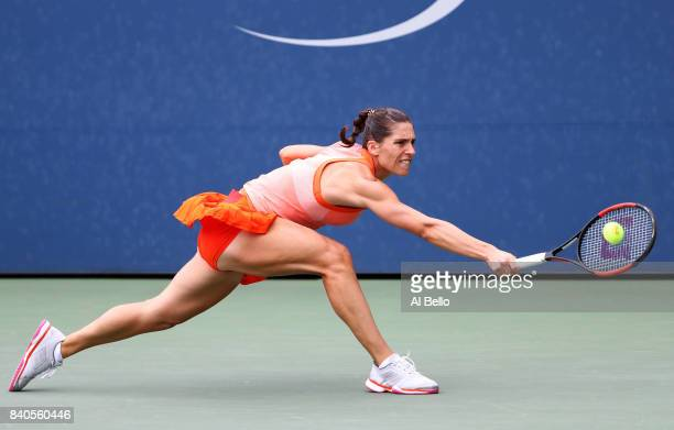 Andrea Petkovic of Germany returns a shot to Jennifer Brady of the United States during their first round Women's Singles match on Day Two of the...