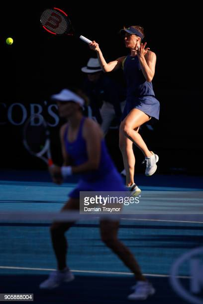 Andrea Petkovic of Germany returns serve in her first round doubles match with Mirjana LucicBaroni of Croatia against Monica Niculescu of Romania and...