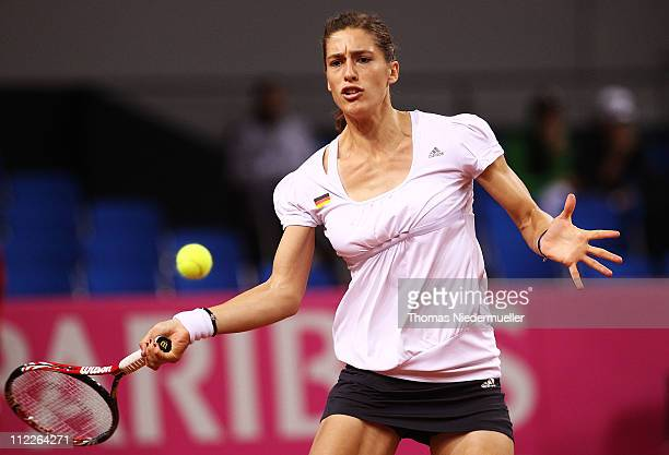 Andrea Petkovic of Germany returns the ball to Christina McHale of the USA during the first day of the Fed Cup match between Germany and United...