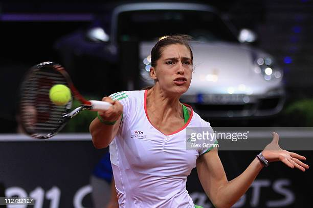 Andrea Petkovic of Germany returns the ball to Jelena Jankovic of Serbia during their second round match at the Porsche Tennis Grand Prix at Porsche...