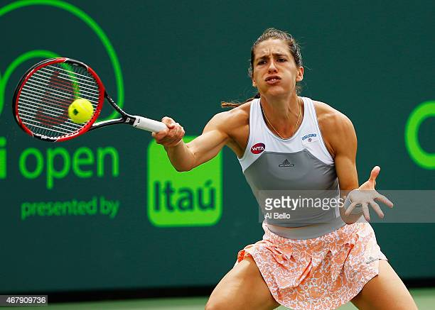 Andrea Petkovic of Germany returns the ball to Kristina Mladenovic of France during day 6 of the Miami Open at Crandon Park Tennis Center on March 28...