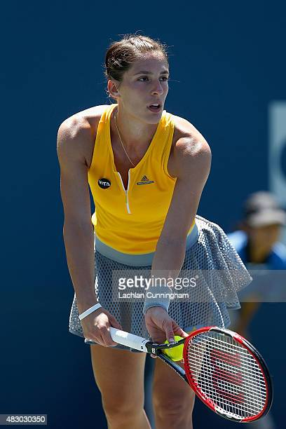 Andrea Petkovic of Germany serves against Mona Barthel of Germany during day three of the Bank of the West Classic at the Stanford University Taube...