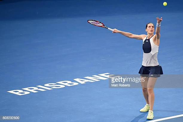 Andrea Petkovic of Germany serves against Teliana Pereira of Brazil during day one of the 2016 Brisbane International at Pat Rafter Arena on January...