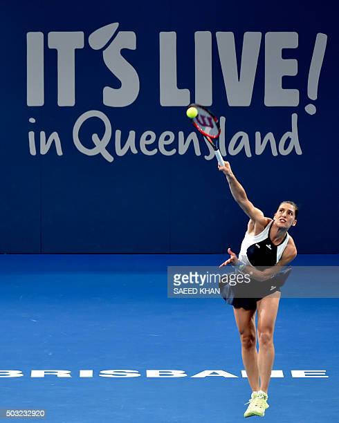 Andrea Petkovic of Germany serves against Teliana Pereira of Brazil in their first round women's singles match at the Brisbane International tennis...