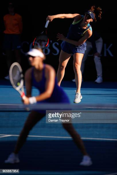 Andrea Petkovic of Germany serves in her first round doubles match with Mirjana LucicBaroni of Croatia against Monica Niculescu of Romania and...
