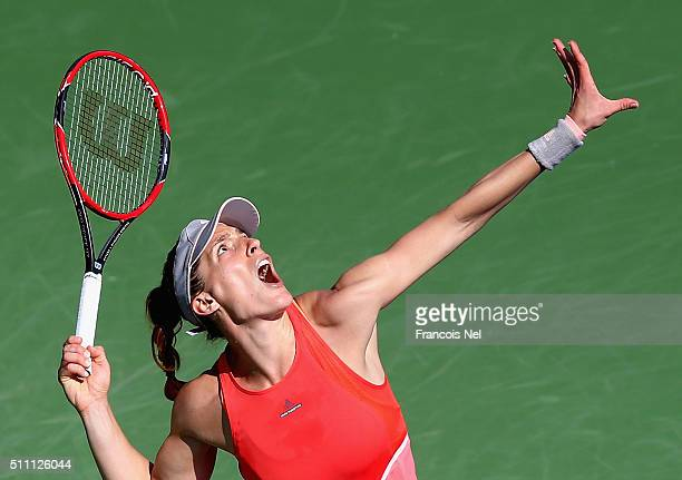 Andrea Petkovic of Germany serves in her match against Caroline Garcia of France during day four of the WTA Dubai Duty Free Tennis Championship at...