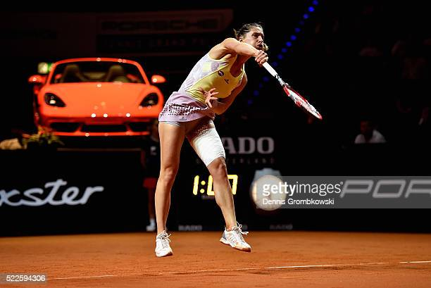 Andrea Petkovic of Germany serves in her match against Kristina Mladenovic of France during Day 3 of the Porsche Tennis Grand Prix at PorscheArena on...